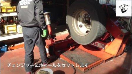 实拍日本修车店工人更换卡车轮胎