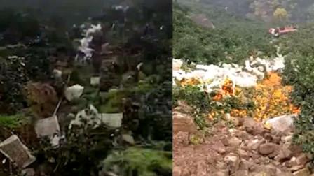 湖北宜昌: 一货车满载脐橙滚落山崖 司机受伤已送医