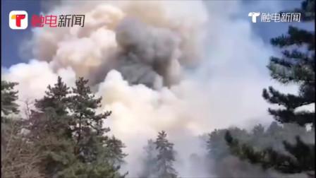 沁源火场北线明火刚扑灭 山顶又起飞火