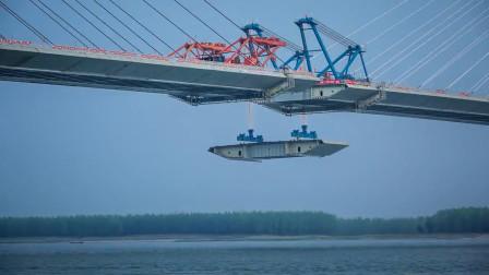 又一座长江大桥胜利合龙,主塔高耸入云,箱梁凌空吊装!