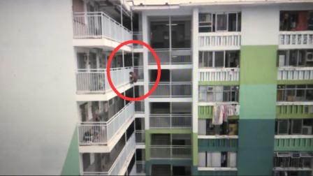 胆战心惊!男子40秒徒手从11层高楼逐层跳下