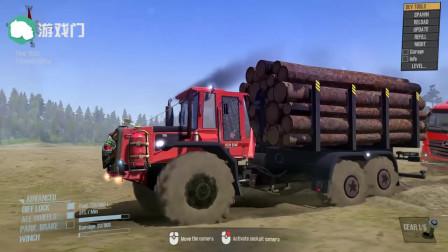 940装载机拖着一辆卡车穿过泥浆