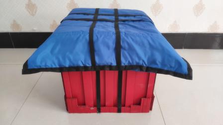 爸爸用纸板为儿子做了个玩具,远看像空投箱,仔细一瞅是个大凳子