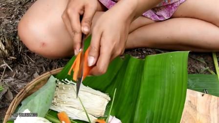 东南亚的野外生存技能,东南亚女人在岩石上的烧烤猪肉当午餐