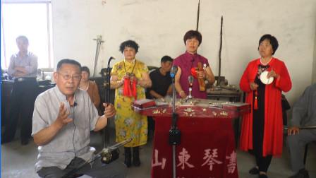 民间艺人演唱山东琴书《鞭打芦花》