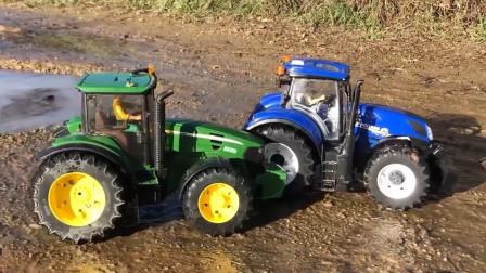 蓝色拖拉机救援陷入泥坑的绿色拖拉机