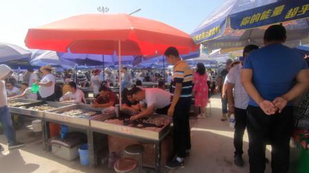 临沂小哥自驾游新疆,来到和田,看看这边的玉交易市场什么样