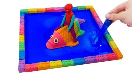 彩泥做的小孩怎么骑在彩虹鱼身上游泳 太空沙玩具太有趣了
