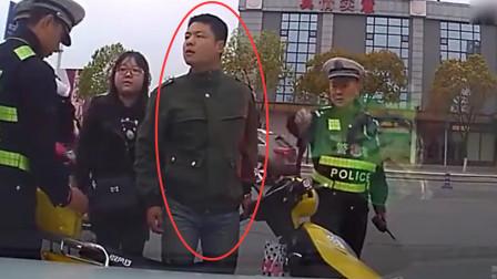 夫妻俩骑电瓶车闯红灯,被撞后疯狂辱骂女司机,自称弱势群体要赔偿!