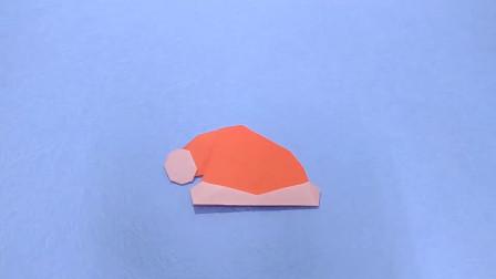 该怎样用纸,折叠一只圣诞帽子?方法就是这么简单