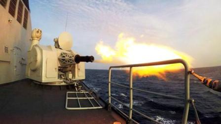 052D驱逐舰火力强悍!各型火炮持续输出,1130炮弹壳如瀑布泼洒