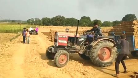 印度人开拖拉机就是不一般,不管遇到什么路,猛踩油门就对了
