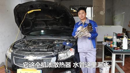 发动机漏油漏水,看如何更换机油散热器密封圈?