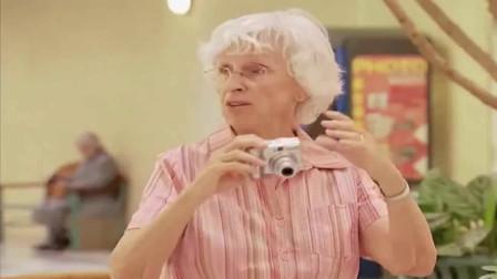爆笑恶作剧:躲在纸板后面拍照的男女