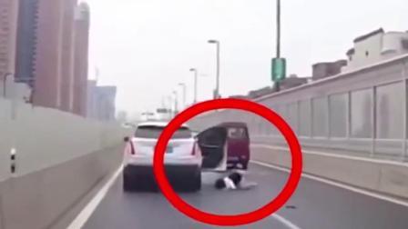 高速上夫妻起争执,女子从车中滚出