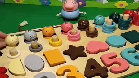 少儿玩具:猪爸爸看到猪妈妈给乔治买的玩具,感觉好玩就玩开了