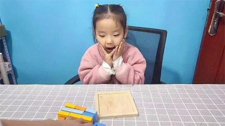 童趣当当:乐乐拼好几何积木就可以吃棒棒糖了!