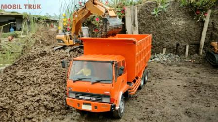大卡车来到工地装载泥土 趣味益智