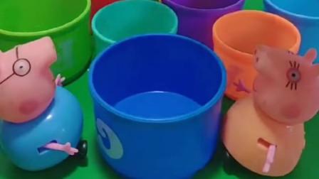 猪爸爸想挑一个杯子,猪妈妈不给猪爸爸,还说这不是水杯
