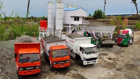 工程卡车和挖掘机移动运送泥土