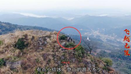 航拍广西横县南山峰顶,登山的游人不少,周边景色尽收眼底