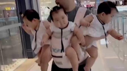 带宝宝去商场有座驾不坐,非要挂在爸爸身上!
