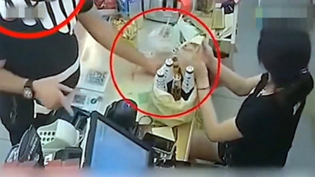 超市内一男子买啤酒,收银员分神的瞬间,监控拍下这无耻一幕!