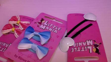 萌娃小可爱有好多漂亮的小发卡,小可爱最喜欢哪个呢