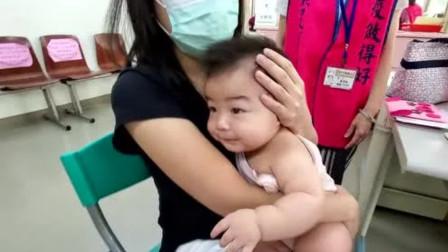 带可爱的小胖妞去打预防针,没想到宝宝太坚强了,只哭3秒就收声!