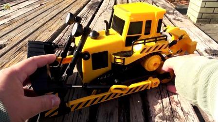 拆箱液压遥控推土机和大型翻斗自卸车玩具