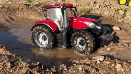 红色拖拉机陷入泥里了一起来救援
