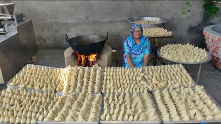 印度老太一次做1000个饺子,做的比包子还大,500个人不够