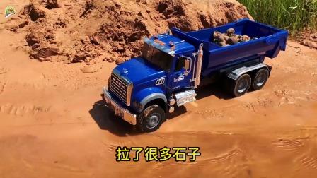 三辆自卸车和铲平车铺路,自卸车拉石子