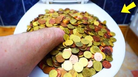 马桶内塞满硬币,按下冲水键后,结果会发生什么?