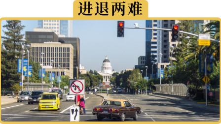 红灯不小心闯了一半,到底是直接开过去还是停在路中间?