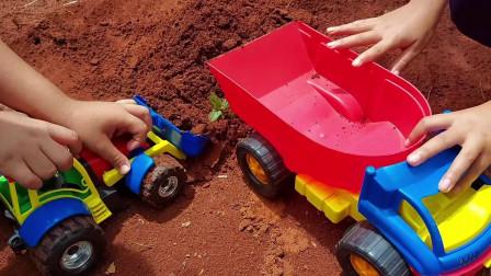 大铲车和自卸车再户外建造一个水池