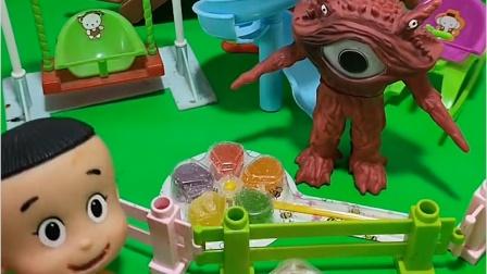 怪兽占了游乐场,还抢小朋友的糖,被奥特曼打跑了