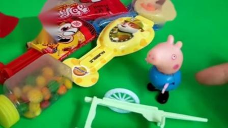 地上有好多糖果,乔治要用小推车装糖果,小推车能装上糖果吗?
