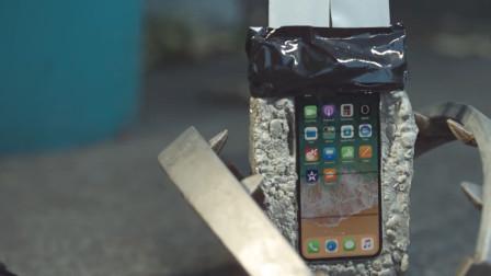 老外拿水泥和捕兽夹亲测iPhoneX,说好的苹果皮薄呢?