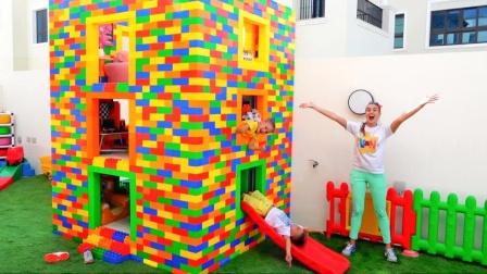 亲子游戏,妈妈和两个小朋友一起搭建了三层楼