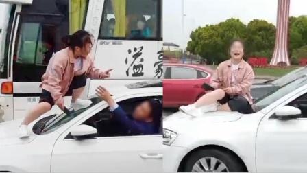 """豪横!只因避让车道发生纠纷,女司机竟当街爬对方引擎盖""""撒泼"""""""