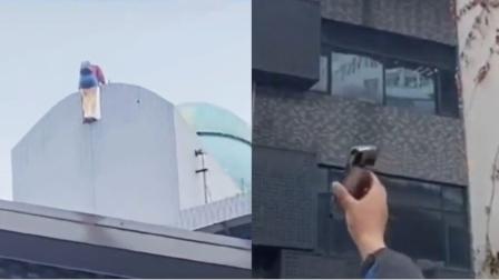 气愤!女子在楼顶欲轻生,路人一旁拍照还怂恿:来123往下跳