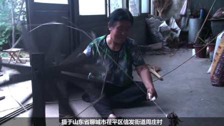 山东茌平:信发街道周庄村农妇纺车纺棉花