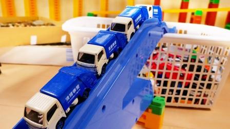 彩色工程车小汽车玩具依次从箱子出发