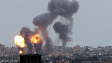 以色列空袭加沙地带 一座13层楼住宅被击中瞬间倒塌