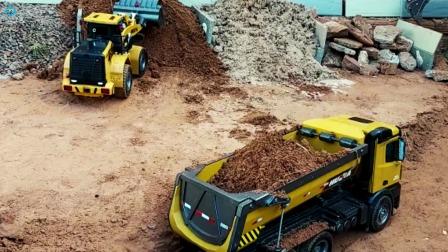 遥控工程车施工,两组工程车铺路装载车挖掘机自卸车运输泥土