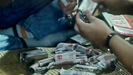 小伙买了一盒烟,拆开发现烟是用钱卷的,立马回去抢空商店