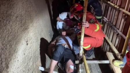 海南三亚一工友不慎掉下10余米深的地下工地,三亚消防成功救出