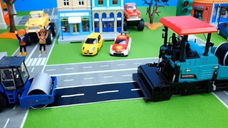 展示工程车功能 挖掘机搬运货物, 压路机模拟压路。