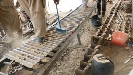 巴基斯坦一家专业维修翻新挖掘机履带的修理厂